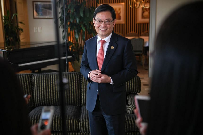 Finance Minister Heng Swee Keat speaks to reporters during a media wrap-up on the second day of the G-20 Leaders Summit in Buenos Aires, on Dec 1, 2018.