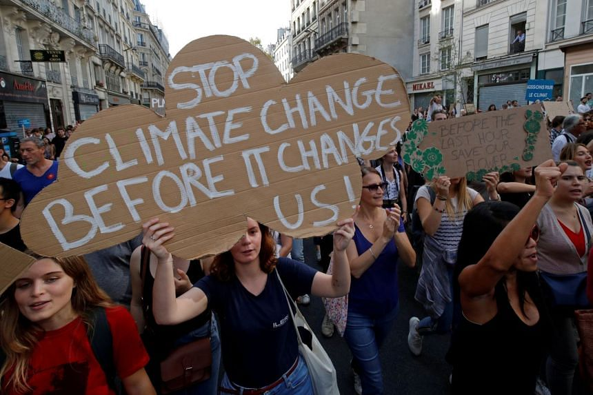 Protesters marching to urge politicians to act against climate change in Paris, France, on Oct 13, 2018.