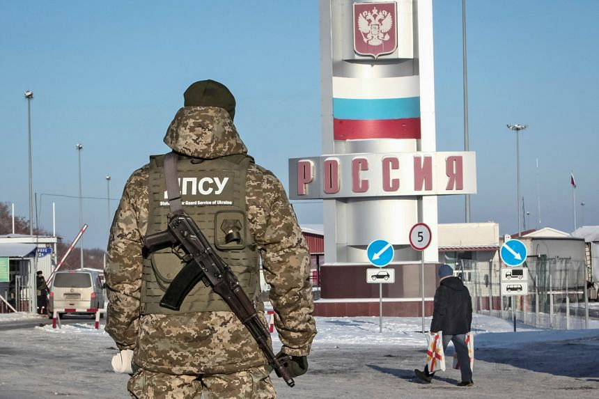 A Ukrainian border guard at the Goptovka crossing point on the Russia-Ukraine border. Moscow has slammed a move by Kiev to bar entry of Russian men aged 16 to 60 to Ukraine.