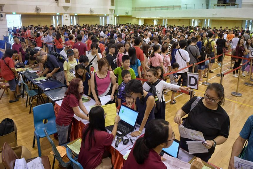 Beneficiaries queueing up for School Ready Packs and Family Packs during the CDAC Ready for School 2018 event at Nanyang Junior College on Dec 2, 2018.
