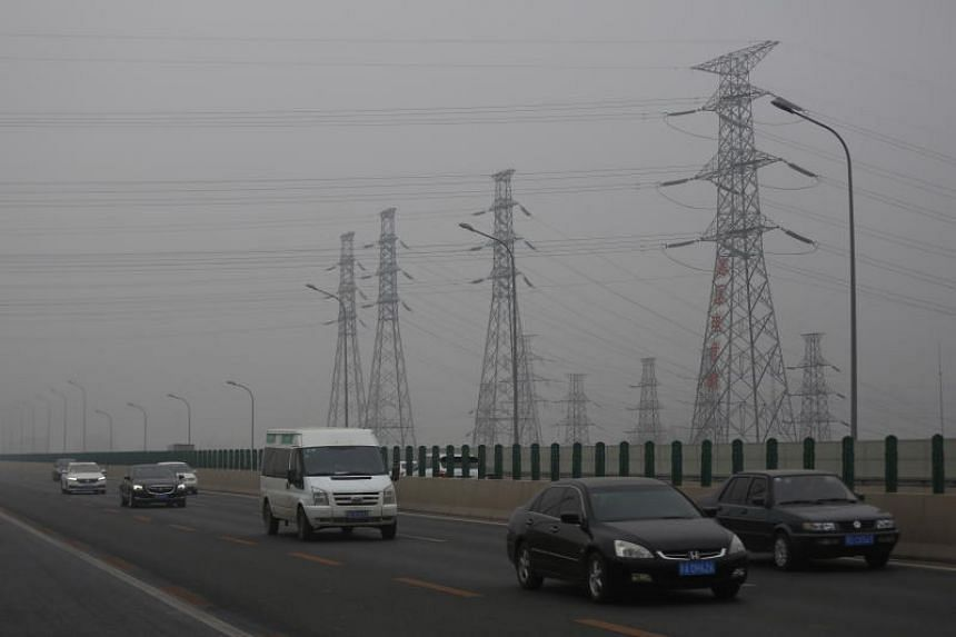 Vehicles travelling under heavy pollution along a road in Beijing on Dec 2, 2018.