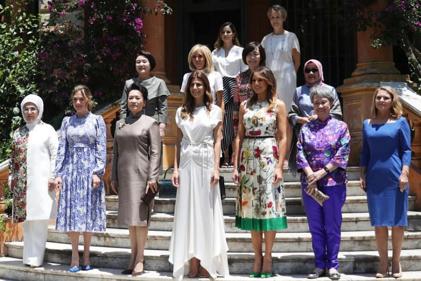 Mrs Lee Hsien Loong (in purple, holding clutch) with other spouses of world leaders in Buenos Aires on Nov 30, 2018. She was accompanying the Prime Minister at the Group of 20 (G-20) summit in Argentina.