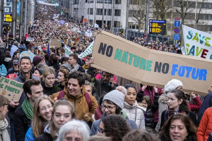 Thousands of people take part in a demonstration on climate change, in Brussels, Belgium, on Dec 2, 2018.