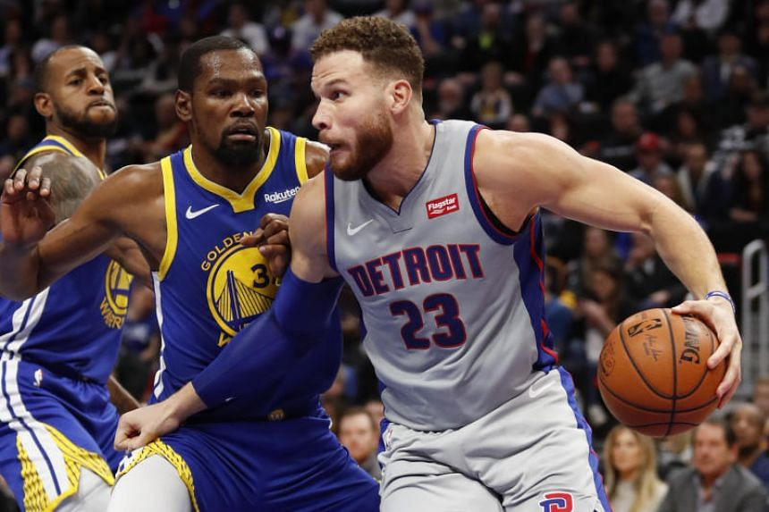 Detroit Pistons forward Blake Griffin (#23) driving against Golden State Warriors forward Kevin Durant (#35) during their NBA match on Dec 1, 2018.