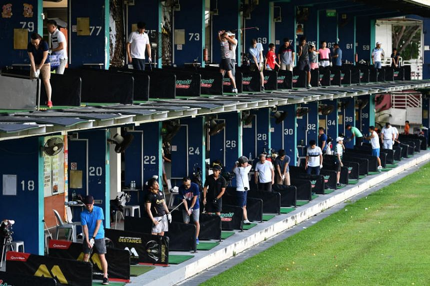 Golfers practising at Toa Payoh Golf Range on its last day of operation, on Dec 2, 2018.