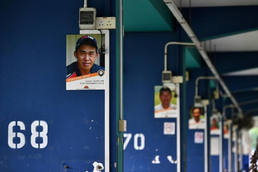 Photographs of the golf coaches are seen on the pillars of Toa Payoh Golf Range.