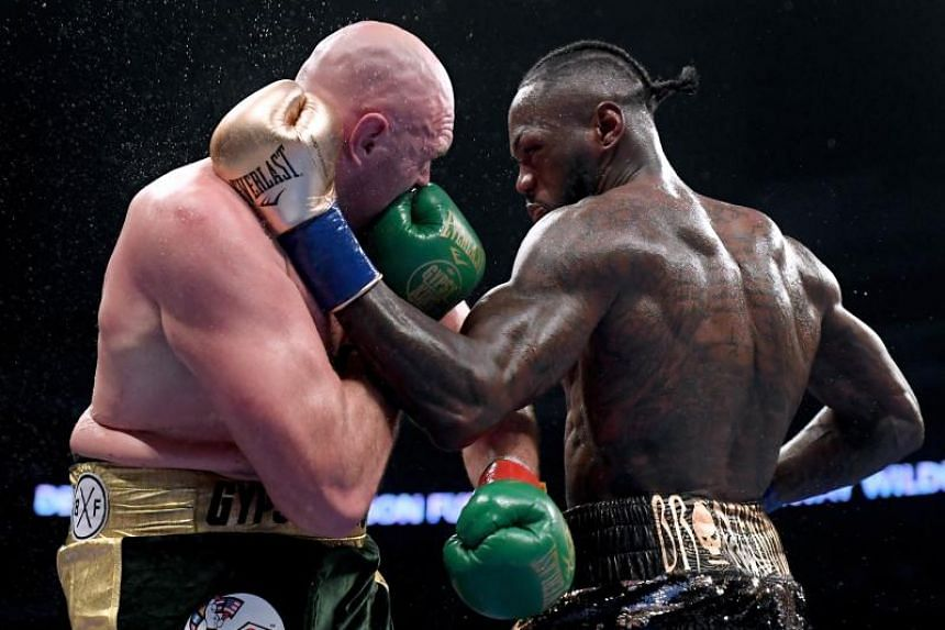 Deontay Wilder (right) and Tyson Fury battling each other in the ninth round of their WBC Heavyweight Championship bout at Staples Centre in Los Angeles on Dec 1, 2018.