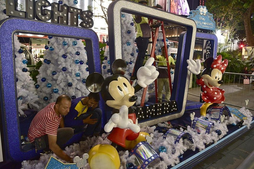 Workers putting up decorations for the Orchard Road Christmas light-up which features Disney characters such as Mickey and Minnie Mouse.