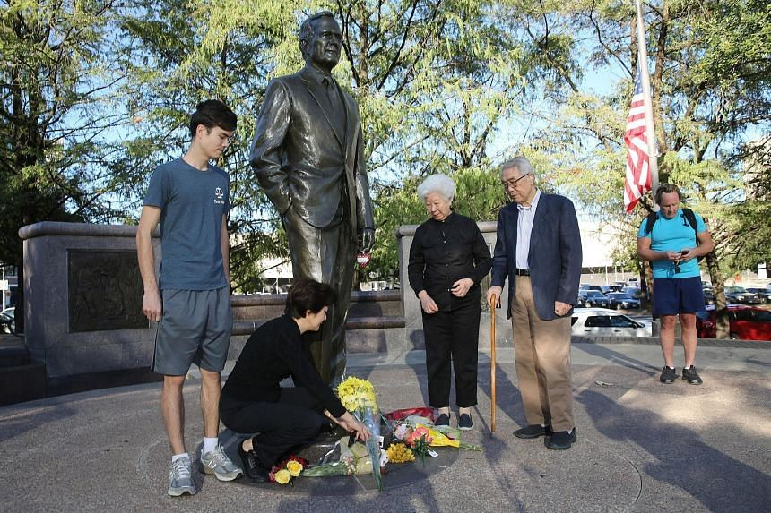 A family paying tribute to former US president George H. W. Bush at his monument in Houston, Texas, on Saturday. A national day of mourning has been declared on Wednesday.