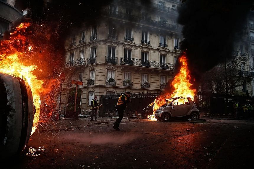 Masked, black-clad groups ran amok across central Paris last Saturday, torching cars and buildings, looting shops, smashing windows and fighting police. The Arc de Triomphe was also ransacked and graffiti was scrawled on the exterior ranging from ant