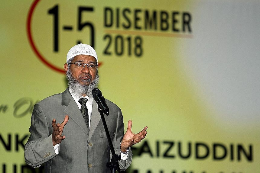 Controversial Islamic preacher Zakir Naik delivering a rare public speech in Malaysia on Saturday. The Malaysian permanent resident faces charges of money laundering and hate speech in his native India.