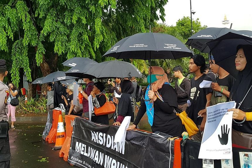 Left: Student activists from Atma Jaya University demonstrating in front of the presidential palace in Jakarta during a protest last month to mark the 20th anniversary of the Semanggi I shooting. Dozens were killed in that incident, as well as in two