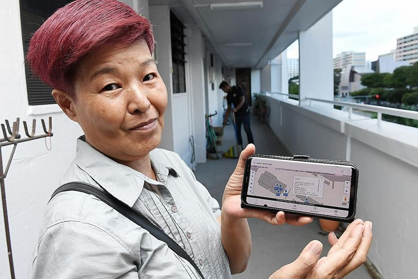 Cleaning supervisor Sally Lim showing how the app tracks a cleaner's progress through a block of flats. Since rolling out its estate monitoring system in September, Tampines Town Council has seen a drop in the number of residents complaining about a