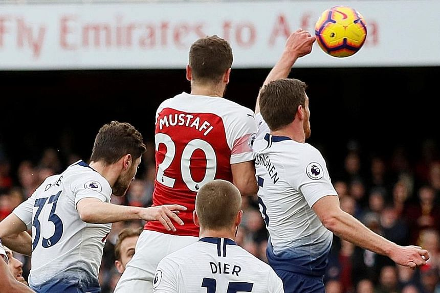 Lucas Torreira's topless celebration, with Pierre-Emerick Aubameyang, after scoring Arsenal's fourth goal against Tottenham in a thrilling north London derby chock-full of incidents. Aubameyang converting the penalty. 30TH: A howler by Gunners goalke