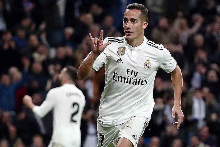 Lucas Vazquez celebrating after scoring his first league goal of the season to round off Real's 2-0 home win over Valencia on Saturday. It was their sixth victory in seven matches under new coach Santiago Solari.
