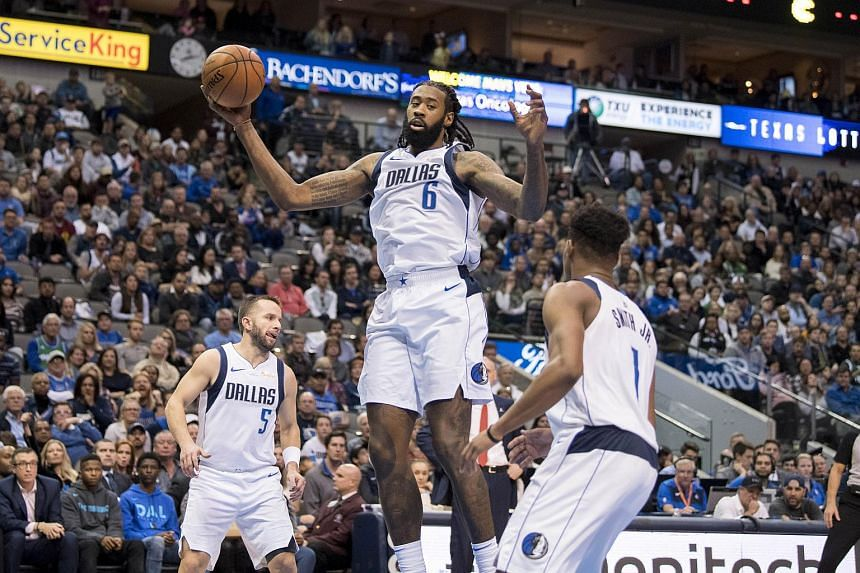Dallas Mavericks center DeAndre Jordan (6) grabs a rebound against the LA Clippers during the second half at the American Airlines Center.