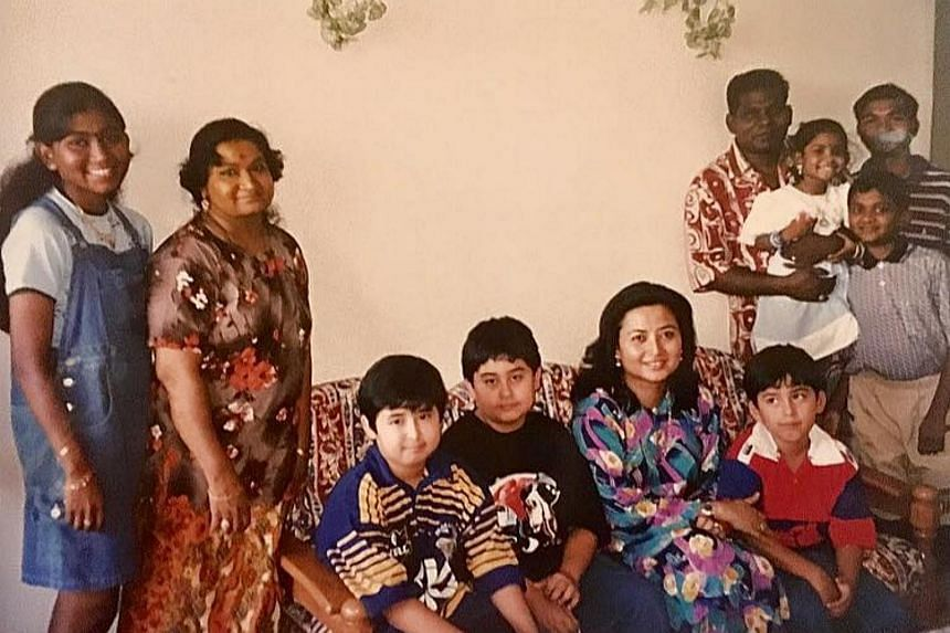 Johor Queen Raja Zarith Sofiah Sultan Idris Shah and her children with Mohan and his family.