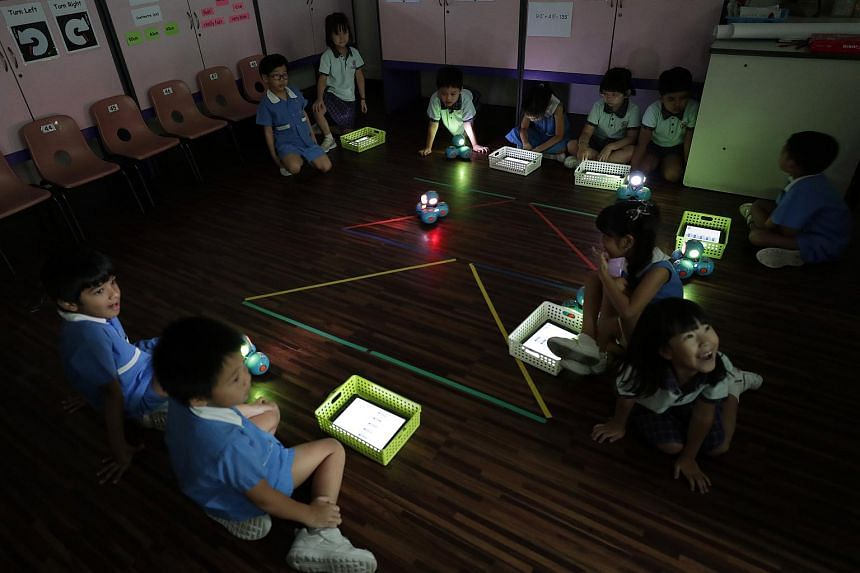 New Life Kindergarten pupils during a coding class, which teaches kids how to code and control robots via tablets, on Oct 8, 2018.