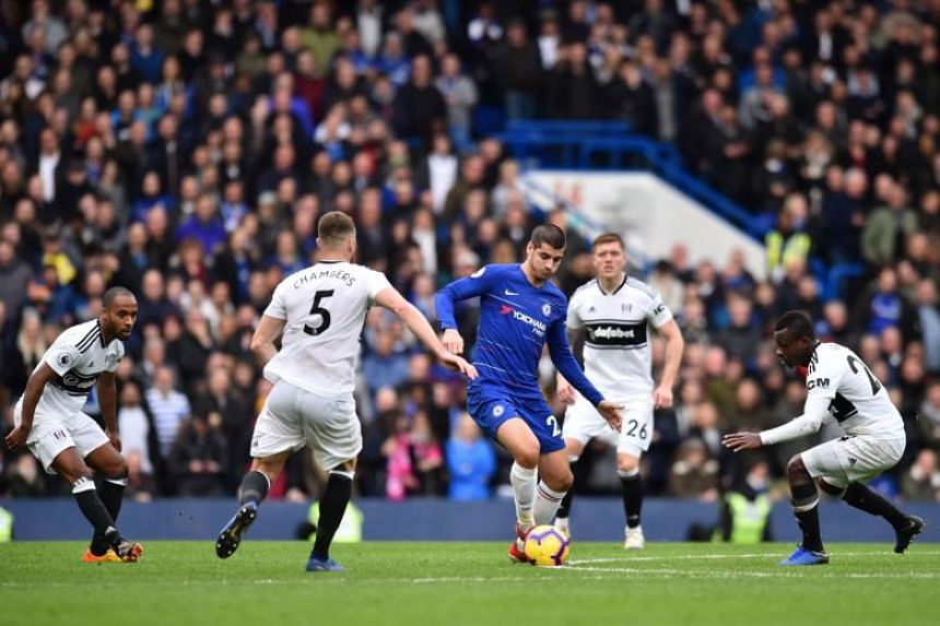Chelsea's Spanish striker Alvaro Morata (centre) is surrounded by Fulham players during the English Premier League football match between Chelsea and Fulham at Stamford Bridge in London on Dec 2, 2018.