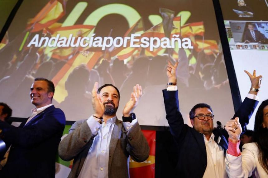Spain's far-right Vox party leader Santiago Abascal (centre) and regional candidate Francisco Serrano (right) celebrate results after the Andalusian regional elections in Seville, Spain, on Dec 2, 2018.