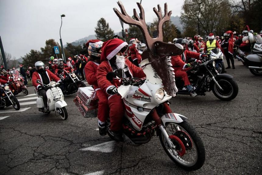 People dressed as Santa Claus take part in the 9th edition of the Santa Claus 'Papa Noel' rally on Dec 2, 2018.
