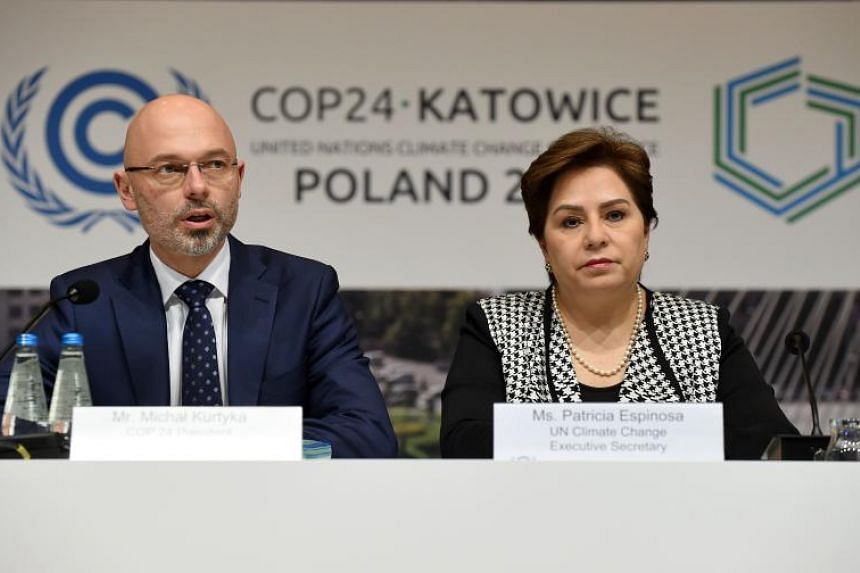 Polish Secretary of State in the Ministry of Environment, Government Plenipotentiary for COP24 Presidency, Michal Kurtyka (left) and Mexican politician Patricia Espinosa, currently serving as executive secretary of United Nations Framework Convention