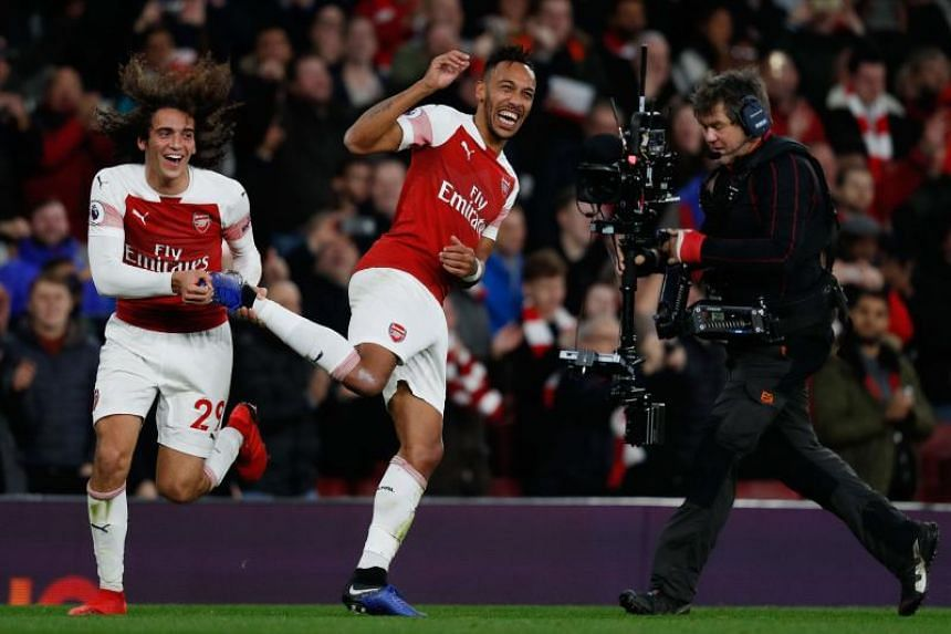 Arsenal's Gabonese striker Pierre-Emerick Aubameyang (right) celebrates with Arsenal's French midfielder Matteo Guendouzi after the EPL match between Arsenal and Tottenham Hotspur at the Emirates Stadium in London, on Dec 2, 2018.
