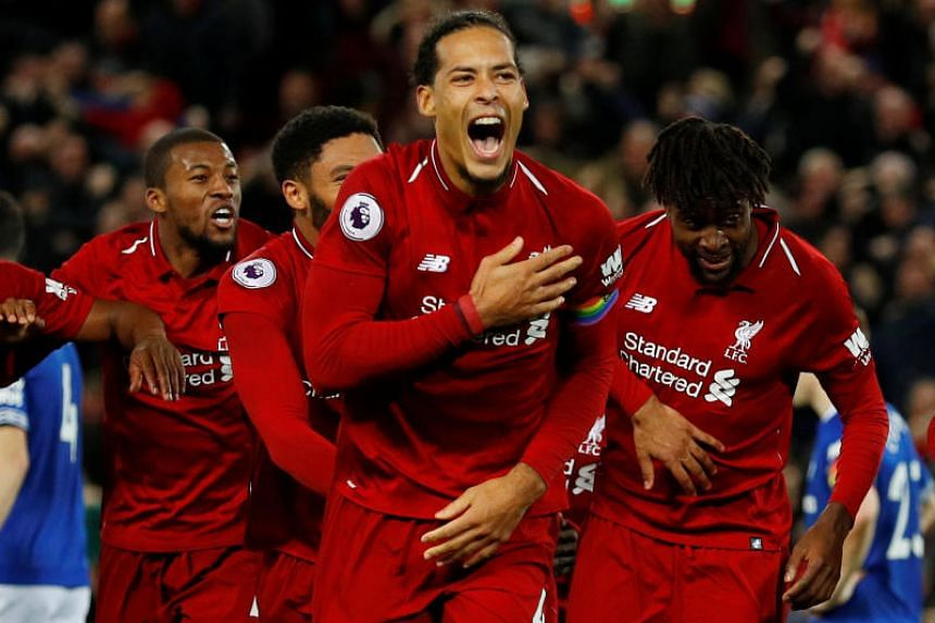 Liverpool's Divock Origi celebrates scoring their first goal with Virgil van Dijk and team mates in the match between Liverpool and Everton at Anfield, Liverpool, Britain, on  Dec 2, 2018.