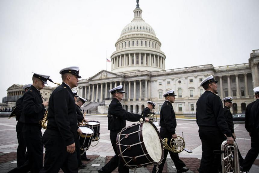 A military band rehearses for an upcoming service for former President George H. W. Bush at the Capitol building in Washington.