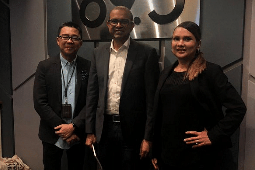 In this Money FM podcast, Senior Minister of State for Transport and Communications and Information Janil Puthucheary (centre) reviews Singapore's Smart Nation journey since it began in 2014.