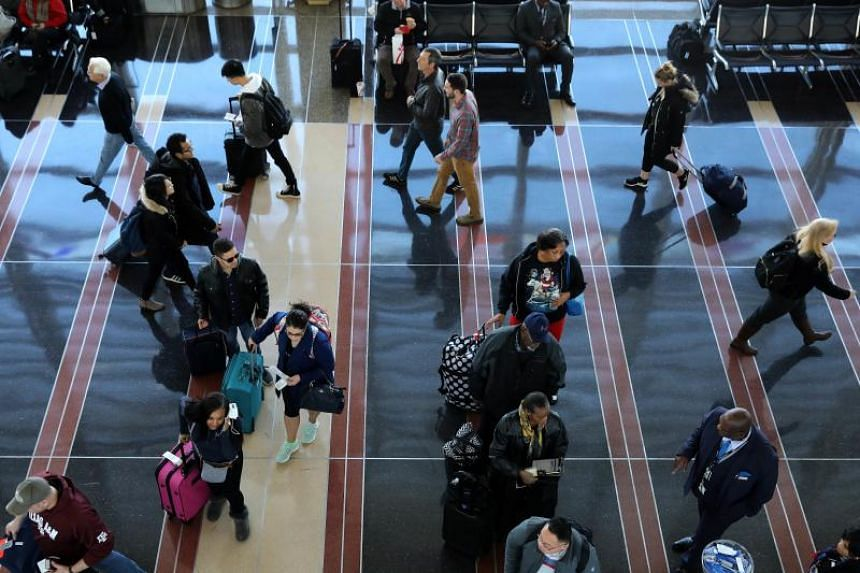 Passengers at Ronald Reagan National Airport in Washington DC before the Thanksgiving holiday on Nov 21, 2018. Scottish grandfather John Stevenson said he had made an honest mistake while filling up an automated online form, but now, it might ruin hi
