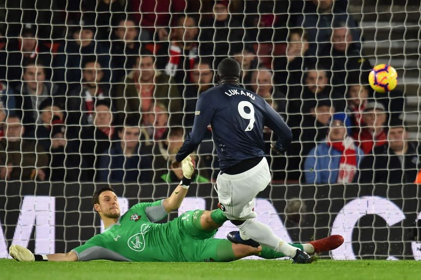 Manchester United's Romelu Lukaku slotting the ball past Southampton goalkeeper Alex McCarthy for the Red Devils' first goal after the Saints had taken an early 2-0 lead. Ander Herrera equalised but, to manager Jose Mourinho, it was two points lo