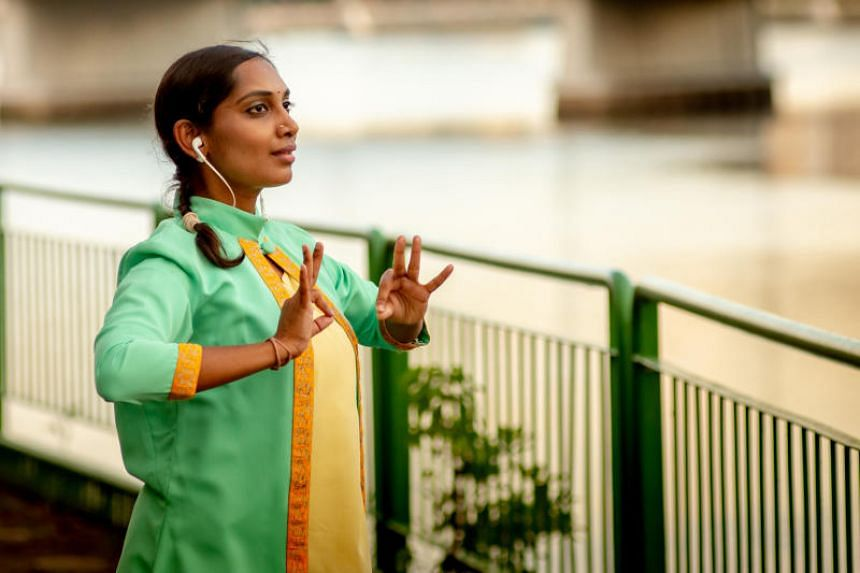 Dr Nidya Shanthini Manokara performing in BITTEN: Return To Our Roots, which the dancer co-created with theatre-maker Thong Pei Qin.