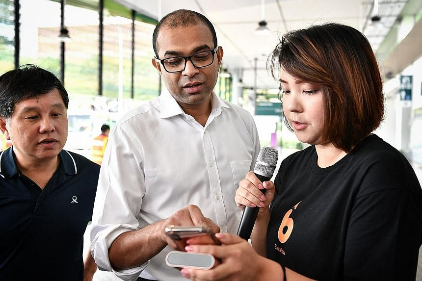 The same boarding code will be displayed in the BusNow mobile app on the driver's tablet and the commuter's smartphone. This will help the driver to confirm that he is picking up the correct passenger. Above: Swat's Ms Charmaine Liew showing Dr Janil