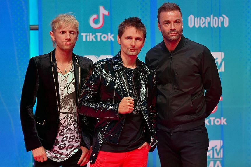 Muse (comprising from left, drummer Dominic Howard, frontman Matt Bellamy and bassist Chris Wolstenholme) will perform at next year's Singapore Grand Prix on Sept 21.