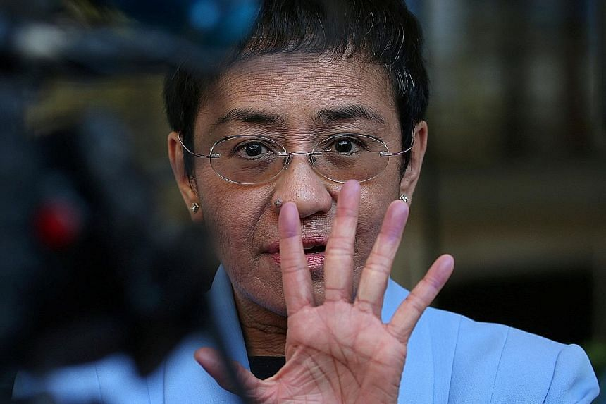 Rappler chief Maria Ressa returns to Manila to fight 'ridiculous' tax charges