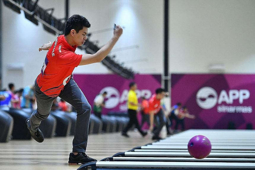 Above: Singapore's Darren Ong, seen here in action at the Asian Games trios competition earlier this year, was one of just two athletes to bowl more than 200 pinfalls in all six games in the World Bowling Men's Championships team-of-five event yester