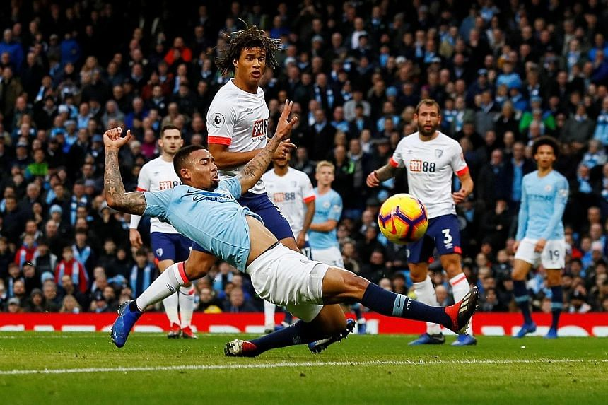 Manchester City's Brazilian striker Gabriel Jesus (front) is finding it tough at the moment, having scored only one league goal this season compared with 13 last term.