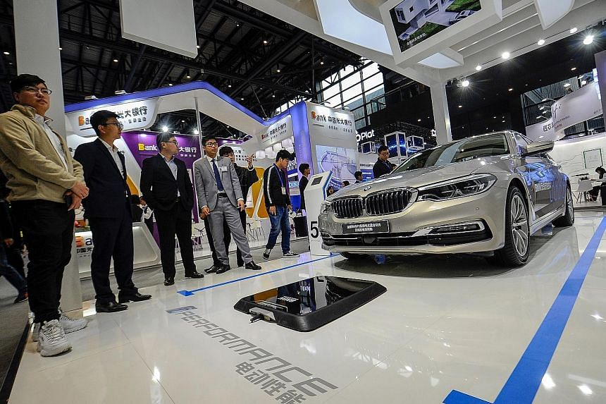 A BMW electric car at the Light of Internet Expo ahead of the 5th World Internet Conference in Wuzhen in China's Zhejiang province last month. A reduction or removal of auto tariffs would be a potential boon for automakers like Tesla and BMW which ma