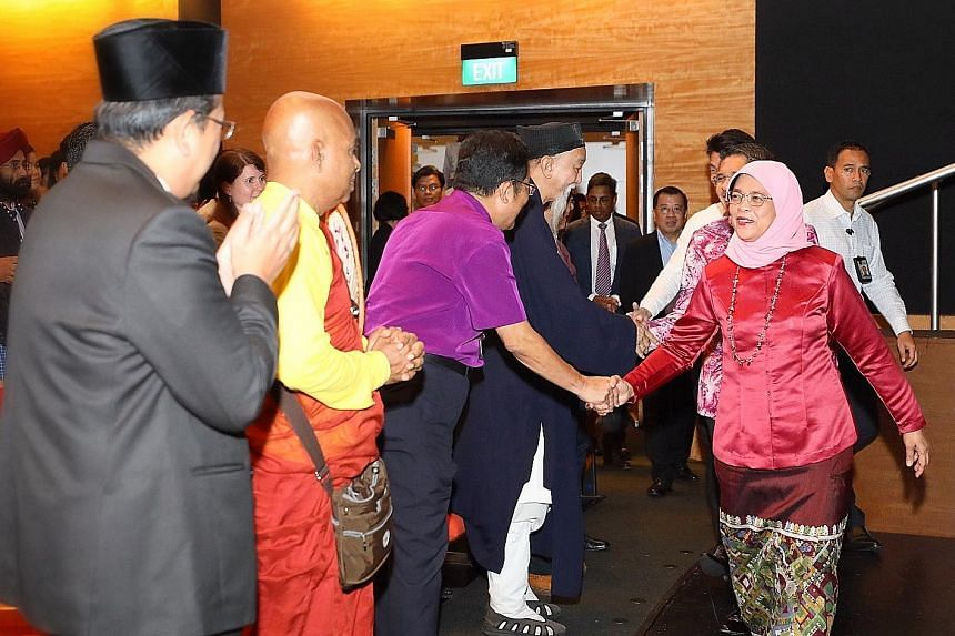 President Halimah Yacob meeting interfaith leaders at the launch yesterday of Faithfully Asean, an inaugural regional interfaith exchange programme.