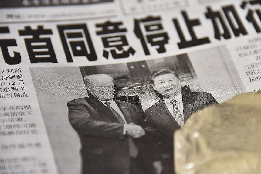 The front page of a newspaper in Beijing yesterday, featuring US President Donald Trump and Chinese President Xi Jinping. While welcoming the truce, the Chinese media warned that trade remained a complex issue.