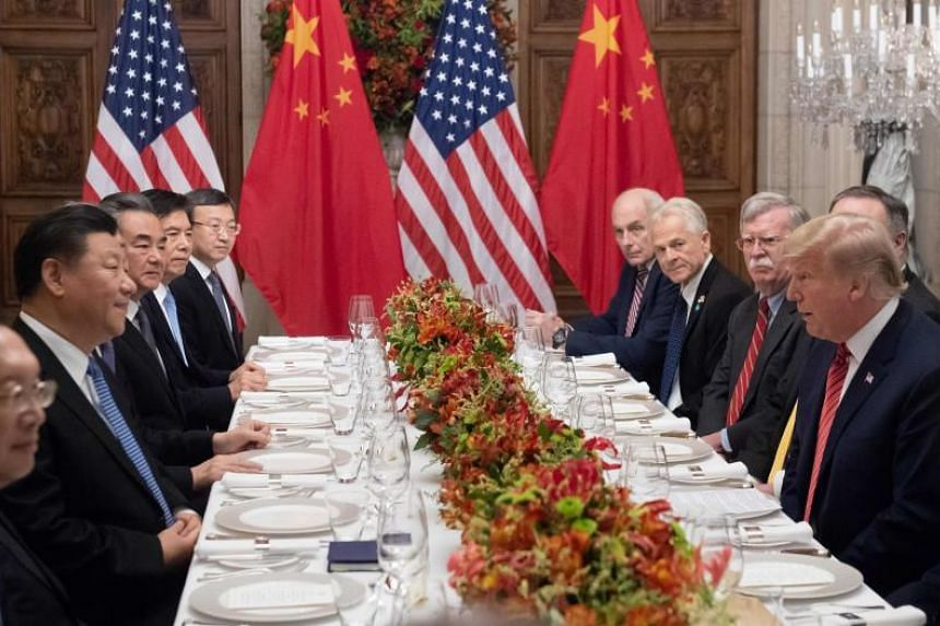 US President Donald Trump (right) and Chinese President Xi Jinping (left), along with members of their delegations, holding a dinner meeting at the end of the G-20 Leaders' Summit in Buenos Aires on Dec 1, 2018.
