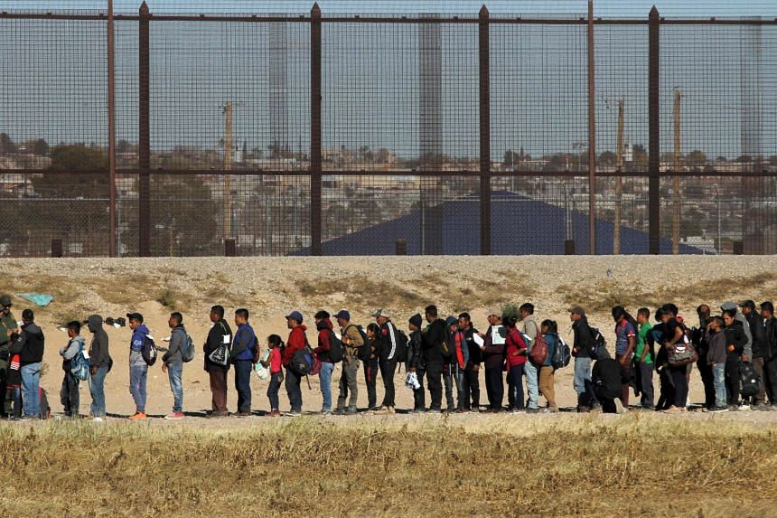 Central American migrants seeking political asylum in the United States being detained by the Border Patrol, on Dec 3, 2018.