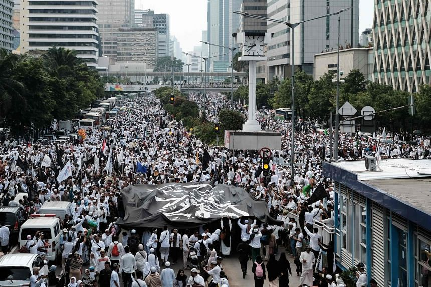 """Indonesian Islamists attend a rally in Jakarta on Dec 2, 2018, to commemorate the second anniversary of a demonstration which led to the fall of Jakarta's then Christian governor Basuki """"Ahok"""" Tjahaja Purnama."""