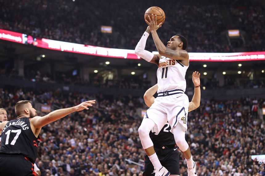 Denver Nuggets guard Monte Morris shoots a basket against the Toronto Raptors during their NBA game at Scotiabank Arena in Toronto on Dec 3, 2018.