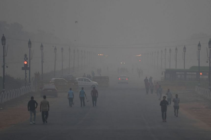 India's National Green Tribunal penalised the capital administration for its lack of oversight after it emerged some polluting industries were still burning harmful waste in the open.