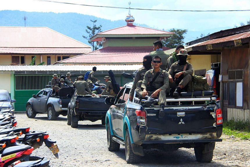 Indonesian Mobile Brigade Police head to Nduga, Papua, where 31 construction workers are believed to have been shot dead, on Dec 4, 2018.