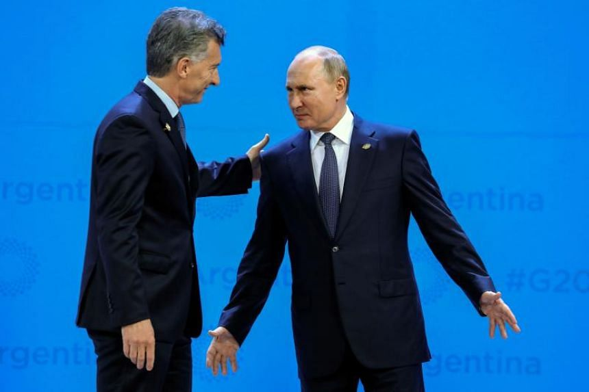 Russia's President Vladimir Putin (right) speaks with Argentina's President Mauricio Macri during the G-20 Leaders' Summit family photo in Buenos Aires on Nov 30, 2018.