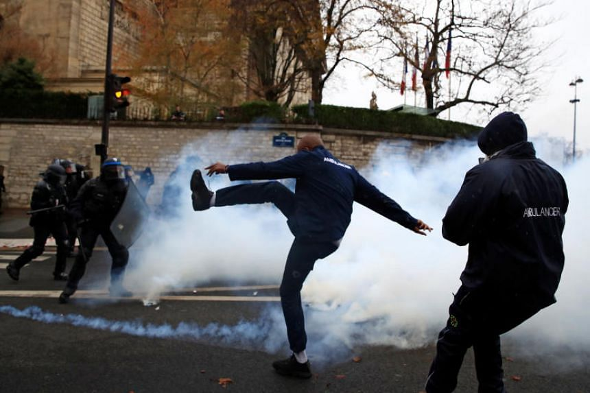 French ambulance drivers face off with French riot police during a demonstration at the Place de la Concorde in Paris, France, on Dec 3, 2018.