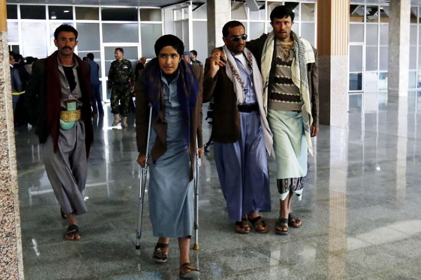 Wounded Houthi fighters wait to be evacuated from the Sanaa International Airport, in Sana'a, Yemen, on Dec 3, 2018.